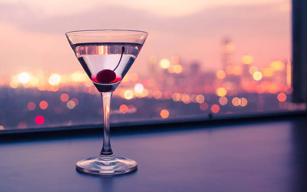 cocktail with Seattle skyline behind it