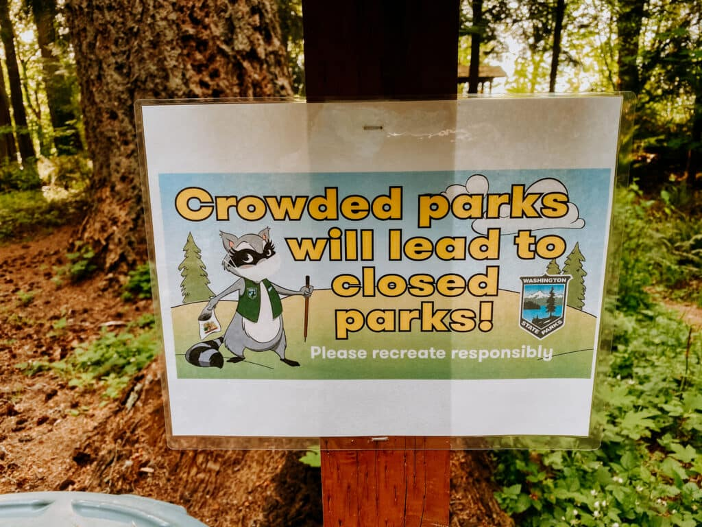 crowded park sign