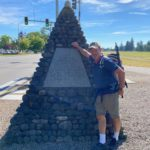 Jerry Kenyon in front of monument
